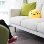 Colorful and Funny Pillows on Sofa in Modern Startup Office